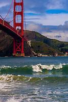 Surfing at Fort Point (Golden Gate Bridge in background), San Francisco, California USA