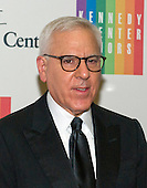 David M. Rubenstein, co-founder and co-chief executive officer of The Carlyle Group and chairman of the Kennedy Center for the Performing Arts, arrives for the formal Artist's Dinner honoring the recipients of the 2014 Kennedy Center Honors hosted by United States Secretary of State John F. Kerry at the U.S. Department of State in Washington, D.C. on Saturday, December 6, 2014. The 2014 honorees are: singer Al Green, actor and filmmaker Tom Hanks, ballerina Patricia McBride, singer-songwriter Sting, and comedienne Lily Tomlin.<br /> Credit: Ron Sachs / Pool via CNP