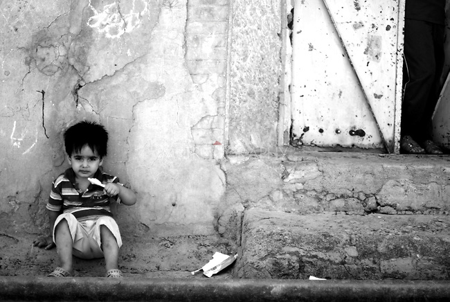 ERBIL, IRAQ: Little boy enjoying an ice cream. .Exploring the old markets of Erbil during a hot afterrnoon.
