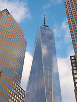 One World Trade Center towers above other nearby buildings of Battery Park City in New York City.