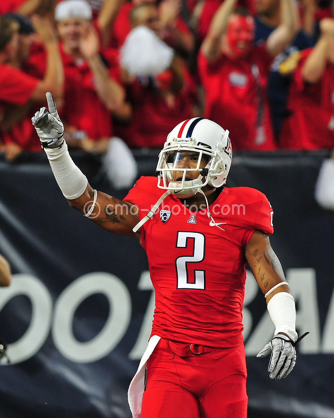 Sept 18, 2010; Tucson, AZ, USA; Arizona Wildcats cornerback Mike Turner (2) gestures to the crowd prior to the start of a game against the Iowa Hawkeyes at Arizona Stadium.  Arizona won the game 34-27.