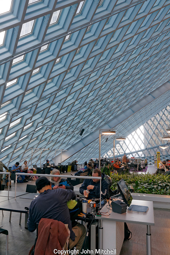 People seated  in the Living Room on Level 3  of Seattle Central Library building in downtown Seattle, Washington state, USA