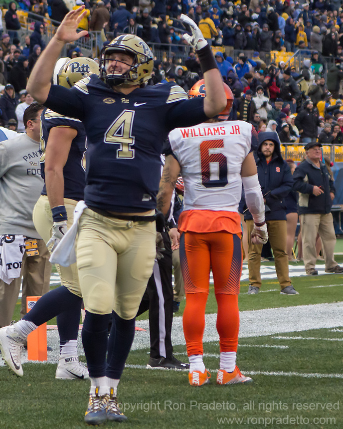 Pitt quarterback Nathan Peterman celebrates his 13-yard touchdown run. The Pitt Panthers defeated the Syracuse Orange 76-61 at Heinz Field in Pittsburgh, Pennsylvania on November 26, 2016.