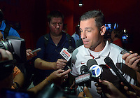 NWA Democrat-Gazette/BEN GOFF • @NWABENGOFF<br /> Dan Enos, offensive coordinator, speaks to the media on Sunday Aug. 9, 2015 during Arkansas football media day at the Fred W. Smith Football Center in Fayetteville.