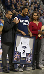 Nevada's Corey Henson (2) holds his framed jersey as his family looks on during senior night before an NCAA college basketball game against San Diego State in Reno, Nev., Saturday, March 9, 2019. (AP Photo/Tom R. Smedes)