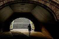 A woman walks inside of a bridge at central park in New York.  06/05/2015. Eduardo MunozAlvarez/VIEWpress