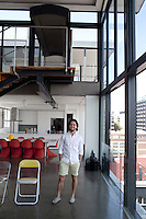Property developer Adam Levy stands in his two-story loft apartment in Braamfontein, Johannesburg, South Africa. Mr. Levy who was working in law, decided to buy a building ten years ago and he converted it into seven spacious floor-through apartments including his own duplex penthouse over looking Johannesburg and sized at 550 square meters. He has since then bought several buildings in the area and helped the area to be a lively spot. (Photograph by: Per-Anders Pettersson)