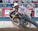 Tommy Cook competes in the steer wrestling event at the Reno Rodeo, in Reno, Nev. on Friday night, June 22, 2012..Photo by Cathleen Allison
