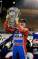 Nov. 13, 2009; Avondale, AZ, USA; NASCAR Camping World Truck Series driver Ron Hornaday celebrates after clinching the 2009 championship following the Lucas Oil 150 at Phoenix International Raceway. Mandatory Credit: Mark J. Rebilas-