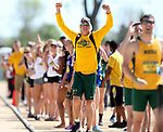 FARGO, ND - MAY 13: A member of the North Dakota track team celebrates the Bison winning both the women's and men's team championship Saturday at the 2017 Summit League Outdoor Track Championship at the Ellig Sports Complex in Fargo, ND. (Photo by Dave Eggen/Inertia)