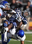 Nevada's Stefphon Jefferson (25) is tackled by Boise State's Darian Thompson (35) and Jeremy Loane (10) during the first half of a NCAA college football game on Saturday, Dec. 1, 2012,  in Reno, Nev. (AP Photo/Cathleen Allison)
