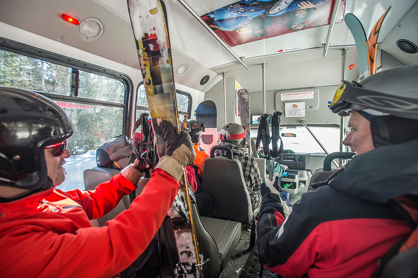 Skiers at Mount Bohemia ski area in Michigan catch a shuttle bus from the base of the Extreme Backcountry area back to the ski lift for another run.