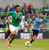 June 4th 2017, Aviva Stadium, Dublin, Ireland; International football friendly, Republic of Ireland versus Uruguay; Cyrus Christie (Republic of Ireland) gets away from Jonathan Urretaviscaya (Uruguay)