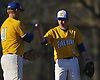 Thomas Paulich #4, Kellenberg third baseman, right, gives a fist bump to pitcher Michael Laskowski #41 before he takes the mound in the top of the seventh inning of a Nassau-Suffolk CHSAA varsity baseball game against St. John the Baptist at Eisenhower Park on Tuesday, April 18, 2017. Paulich drove in two runs while Laskowski notched a save after tossing 1 1/3 innings of scoreless relief in Kellenberg's 6-2 win