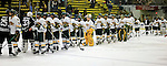 30 November 2009: The University of Vermont Catamounts line up to congratulate the Yale University Bulldogs at Gutterson Fieldhouse in Burlington, Vermont. The Catamounts shut out the Bulldogs 1-0 in a rematch of last season's first round of the NCAA post-season playoff Tournament. Mandatory Credit: Ed Wolfstein Photo