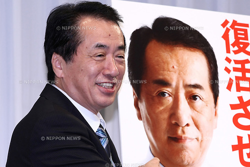 June 17, 2010 - Tokyo, Japan - Japanese Prime Minister Naoto Kan, who is also leader of the ruling Democratic Party of Japan (DPJ), poses for photographers beside a campaign poster during a news conference in Tokyo, Japan, on June 17, 2010. Japan's ruling Democratic Party was set to unveil its campaign pledges for elections on July 11, and announced a plan to halve the world's largest public debt in six years.
