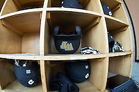 A Wake Forest Demon Deacons batting helmet sits in the dugout helmet rack prior to the game against the Georgetown Hoyas at David F. Couch Ballpark on February 19, 2016 in Winston-Salem, North Carolina.  The Demon Deacons defeated the Hoyas 3-1.  (Brian Westerholt/Four Seam Images)