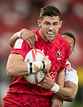 Dan Norton of England (right) tries to stop Justin Douglas of Canada, who runs with the ball during the match Canada vs England, Day 2 of the HSBC Singapore Rugby Sevens as part of the World Rugby HSBC World Rugby Sevens Series 2016-17 at the National Stadium on 16 April 2017 in Singapore. Photo by Victor Fraile / Power Sport Images