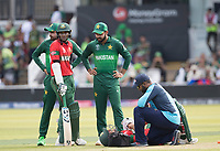 Mahmudullah (Bangladesh) gets treament following a nasty blow during Pakistan vs Bangladesh, ICC World Cup Cricket at Lord's Cricket Ground on 5th July 2019