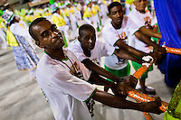 Samba school members push a float during the Carnival Access Group parade at the Sambadrome in Rio de Janeiro, Brazil, 19 February 2012. The Carnival in Rio de Janeiro, considered the biggest carnival in the world, is a colorful, four day celebration, taking place every year forty days before Easter. The Samba school parades, featuring thousands of dancers, imaginative costumes and elaborate floats, are held on the Sambadrome, a purpose-built stadium in downtown Rio. According to costumes, flow, theme, band music quality and performance, a single school is declared the winner of the competition.