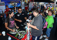 Oct. 27, 2012; Las Vegas, NV, USA: NHRA funny car driver Alexis DeJoria (left with Tony Pedregon during qualifying for the Big O Tires Nationals at The Strip in Las Vegas. Mandatory Credit: Mark J. Rebilas-