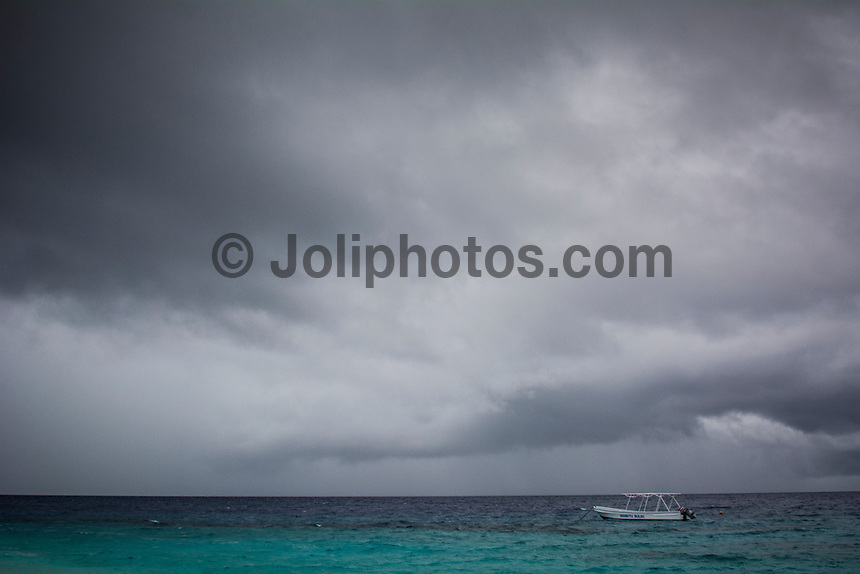 Namotu Island Resort, Fiji. Wednesday February 4 2015) - The surf was still in the 2' range for most of the day with the guests splitting themselves between SUPing and surfing at Namotu Lefts, surfing at Despos and fishing. There were strong winds and rain from the North at times during the day and the Kava night ceremonies were moved inside but the weather was not as bad as forecast.   Photo: joliphotos.com