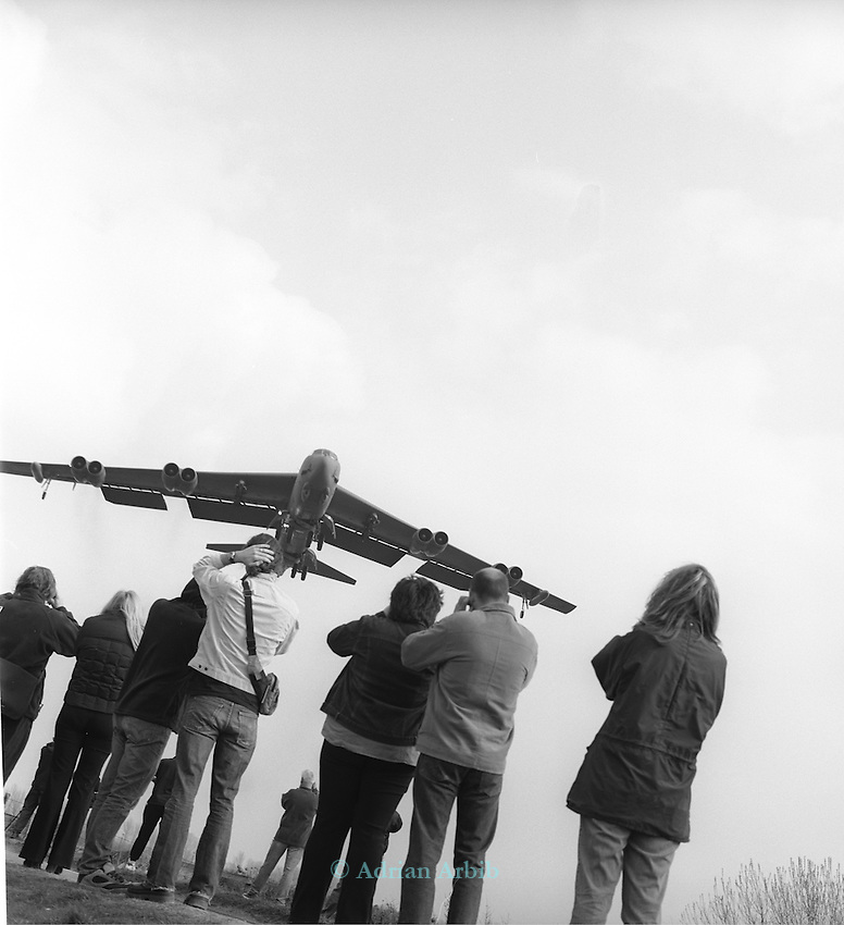 A B52  bomber returns to RAF Fairford  after a  bombing mission to Bagdhad during the war against Iraq. Passing over the  gathered crowds that have come to spectate..