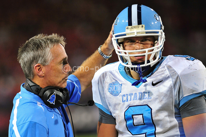 Sept 11, 2010; Tucson, AZ, USA; Citadel Bulldogs head coach Kevin Higgins consoles his backup quarterback Sam Martin (9) in the 3rd quarter of a game against the Arizona Wildcats at Arizona Stadium. Arizona won the game 52-6.