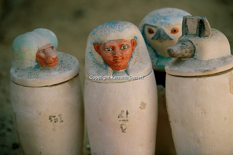 Canopic jars of Pakerdemamon with stoppers of the four sons of Horus, Hapy, Duamutef, Qubehsenuef, Imsety