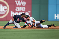 Yoan Moncada (10) of the Charlotte Knights is tagged out by Gwinnett Braves shortstop Ozzie Albies (1) as he tries to steal second base at BB&T BallPark on July 16, 2017 in Charlotte, North Carolina.  The Knights defeated the Braves 5-4.  (Brian Westerholt/Four Seam Images)