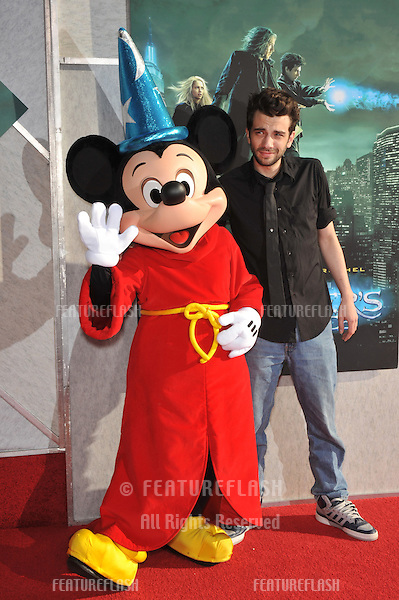 "Jay Baruchel & Mickey Mouse at a benefit screening for his new movie ""The Sorcerer's Apprentice"" at Walt Disney Studios..July 12, 2010  Burbank, CA.Picture: Paul Smith / Featureflash"