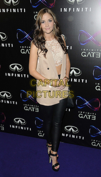 Jacqueline Jossa<br /> The Infiniti Gate Experience launch party, London Film Museum Covent Garden, London, England.<br /> July 11th, 2013<br /> full length black beige sleeveless jacket lace top cropped belly stomach midriff leggings <br /> CAP/CAN<br /> &copy;Can Nguyen/Capital Pictures