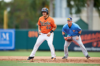 Baltimore Orioles Jose Montanez (62) leads off first base in front of first baseman Brendan McKay during an Instructional League game against the Tampa Bay Rays on October 5, 2017 at Ed Smith Stadium in Sarasota, Florida.  (Mike Janes/Four Seam Images)