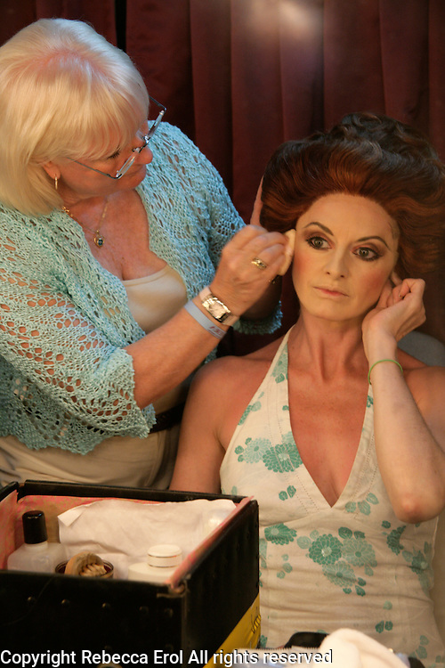 Royal Ballet character artist, Elizabeth McGorian, putting on stage make-up and having her wig fitted for her role as Madame in the ballet Manon
