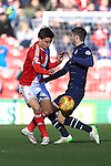 Jelle Vossen of Middlesbrough and Luke Murphy of Leeds contest a loose ball - Middlesbrough vs. Leeds United - Skybet Championship - Riverside Stadium - Middlesbrough - 21/02/2015 Pic Philip Oldham/Sportimage