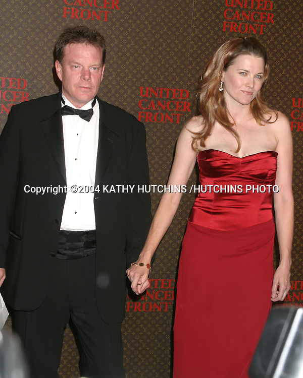 ©2004 KATHY HUTCHINS /HUTCHINS PHOTO.LOUIS VUITTON UNITED CANCER FRONT GALA.LOS ANGELES, CA.NOVEMBER 8, 2004..LUCY LAWLESS.HUSBAND