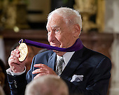 Mel Brooks, Actor, Comedian, & Writer of New York, New York, shows off his new 2015 National Medal of Arts after receiving it from United States President Barack Obama during a ceremony in the East Room of the White House in Washington, DC on Thursday, September 22, 2016.<br /> Credit: Ron Sachs / CNP