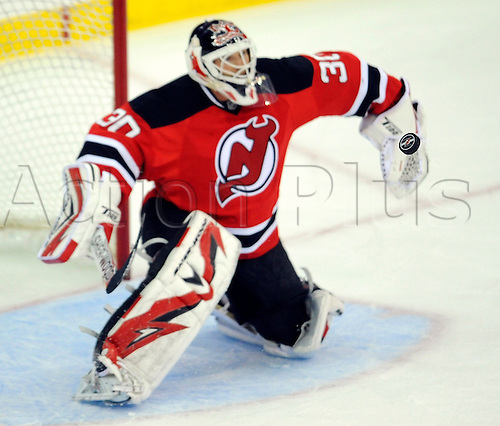 29th September 2009: New Jersey Devils goalie Martin Brodeur (30) gets ready to make a save during the first period of the Devils 4-2 win over the Islanders in a preseason game at the Prudential Center in Newark, NJ.  (Photo by Rich Kane/ActionPlus). UK Licenses Only