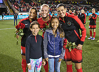 Portland, Oregon - Sunday September 11, 2016: Portland Thorns FC forward Nadia Nadim (9), Dagny Brynjarsdottir and Christine Sinclair pose with the Girls of the Game during a regular season National Women's Soccer League (NWSL) match at Providence Park.