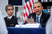 United States President Barack Obama, right, speaks while participating in a roundtable discussion on the impacts of climate change on public health at Howard University with Vivek Murthy, U.S. surgeon general, left. in Washington, D.C., U.S., on Tuesday, April 7, 2015. The President is warning that climate change will start affecting Americans' health in the near future and he is recruiting top technology companies to help prepare the nation's health systems.<br /> Credit: Andrew Harrer / Pool via CNP