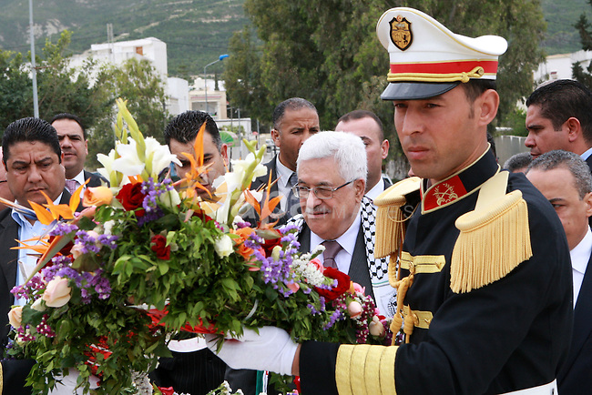 Palestinian President, Mahmoud Abbas (Abu Mazen), lays a wreath of flowers at the memorial to the martyrs of the Israeli raid in the hamam Al shat of Tunisia, in Tunis, on April 29, 2012. Photo by Thaer Ganaim