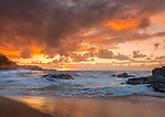 Kauai, H:I Evening clouds from Lumaha'i Beach with colors of the sky reflecting on the surf and beach