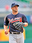 2 April 2011: Atlanta Braves infielder Dan Uggla warms up prior to a game against the Washington Nationals at Nationals Park in Washington, District of Columbia. The Nationals defeated the Braves 6-3 in the second game of their season opening series. Mandatory Credit: Ed Wolfstein Photo