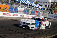 #56 BMW of Dirk Muller and John Edwards, Long Beach Grand Prix, Long Beach, CA, April 2014.  (Photo by Brian Cleary/ www.bcpix.com )
