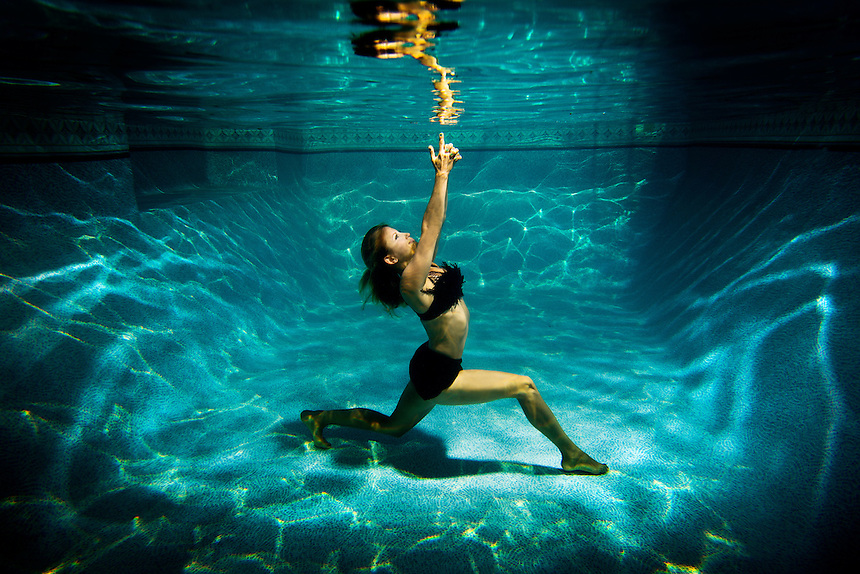 Photo by K.C. Alfred c 2013 A female underwater fashion model.