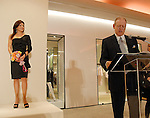 Honoree Ericka Bagwell onstage and Jack Sweeny at the microphone at the Houston Chronicle's Best Dressed announcement party at Neiman Marcus Wednesday Jan. 28, 2009.(Dave Rossman/For the Chronicle)