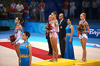 August 23, 2008; Beijing, China; (L-R) Rhythmic gymnasts Anna Bessonova of Ukraine (bronze), Evgenia Kanaeva of Russia (gold), Inna Zhukova of Belarus (silver) listen to anthem playing during Individual All-Around medals ceremony at 2008 Beijing Olympics..(©) Copyright 2008 Tom Theobald
