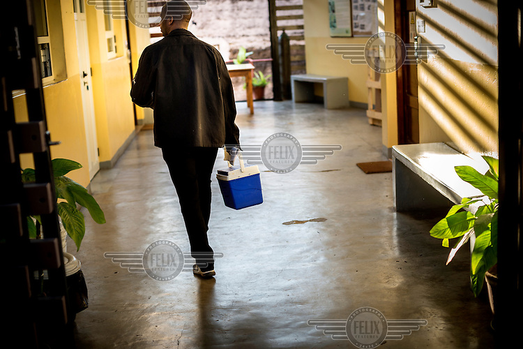 A man walks through the CISM Health Research Centre.