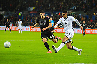 2nd January 2020; Liberty Stadium, Swansea, Glamorgan, Wales; English Football League Championship, Swansea City versus Charlton Athletic; Ben Cabango of Swansea City clears the ball under pressue from Josh Davison of Charlton Athleic  - Strictly Editorial Use Only. No use with unauthorized audio, video, data, fixture lists, club/league logos or 'live' services. Online in-match use limited to 120 images, no video emulation. No use in betting, games or single club/league/player publications