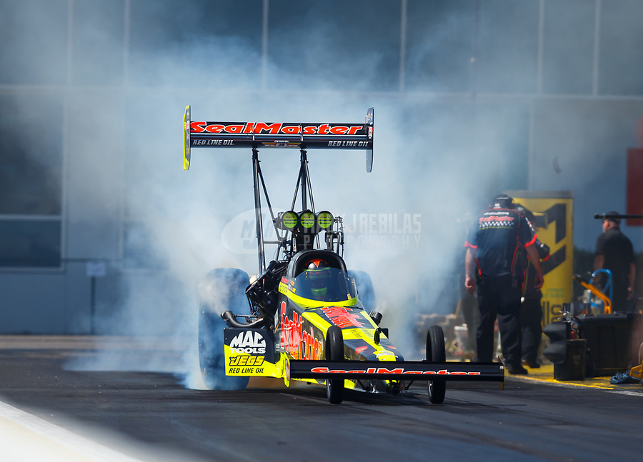 Mar 18, 2017; Gainesville , FL, USA; NHRA top fuel driver Troy Coughlin Jr during qualifying for the Gatornationals at Gainesville Raceway. Mandatory Credit: Mark J. Rebilas-USA TODAY Sports